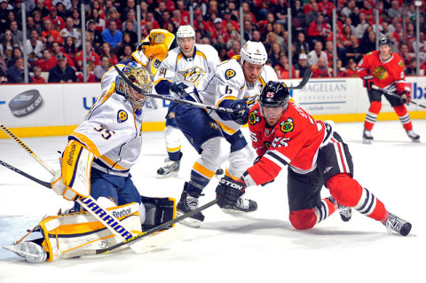 Chicago Blackhawks left wing Viktor Stalberg (25) is defended by Nashville Predators defenseman Shea Weber (6) and goalie Pekka Rinne (35) during the first period at the United Center Sunday night, April 7th, 2013.  (Rob Grabowski - USA TODAY Sports)