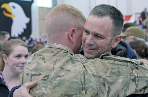 """Spc. Robert Fay Jr., an infantryman from Company D, 3rd Battalion, 187th Infantry Regiment, 3rd Brigade Combat Team """"Rakkasans,"""" 101st Airborne Division, reunites with his father, Robert Fay, a former Rakkasan, March 27 at a welcome home ceremony at Fort Campbell, Ky. Although not at the ceremony, Fay's grandfather is also a former Rakkasan, and the three generations of the Fay family have served the elite 187th Infantry Regiment in several wars dating back to the beginning of its history.(U.S. Army photo taken by Sgt. Alan Graziano, 3rd Brigade Combat Team, 101st Airborne Division)"""