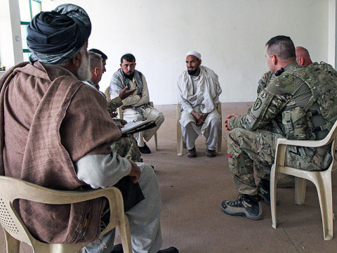 U.S. Army Maj. Gregory Motz, the executive officer for the Khowst Province Provincial Reconstruction Team, of the 5-19th Agribusiness Development Team, Indiana National Guard, along with his team, meets with local farmers and area representatives to discuss various agriculture techniques, in Khowst Province, Afghanistan, March 16, 2013. (U.S. Army Photo by Spc. Brian Smith-Dutton TF 3/101 Public Affairs)