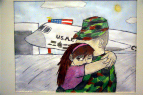 Lauren Sink, a high school junior, drew this picture of her Army father returning home. Nearly 50 illustrations, paintings and writings were on display at the U.S. Education Department on April 3, 2013, in observance of the Month of the Military Child. (Terri Moon Cronk/DOD)