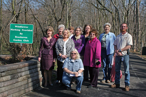Clarksville Mayor Kim McMillan and the Beachaven Garden Club at the wildflower sign installation at Clarksville Greenway.