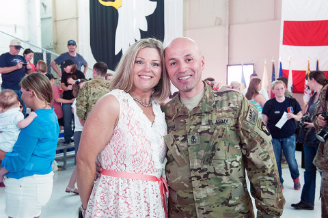 1st Sgt. Jairo Lopera, C Company, 1st Battalion, 101st Combat Aviation Brigade, 101st Airborne Division (Air Assault,) reunites with his wife, Crystal at a welcome home ceremony at Fort Campbell, Ky., May 18, 2013. (U.S. Army photo by Sgt. Duncan Brennan, 101st CAB Public Affairs)