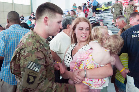 Sgt. Kyle Zobel, Headquarters and Headquarters Company, 101st Combat Aviation Brigade, 101st Airborne Division (Air Assault,) reunites with his wife Christine after returning from a nine-month deployment at Fort Campbell, Ky., May 18, 2013. (U.S. Army photo by Sgt. Duncan Brennan)