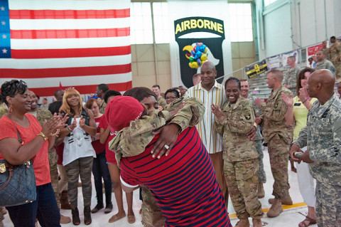Spc. Tocarra Courtrier, Headquarters and Headquarters Company, 101st Combat Aviation Brigade, 101st Airborne Division, embraces Roosevelt Gongob after being proposed to at a welcome home ceremony at Fort Campbell, Ky., May 22, 2013. (U.S. Army Photo by Sgt. Duncan Brennan)