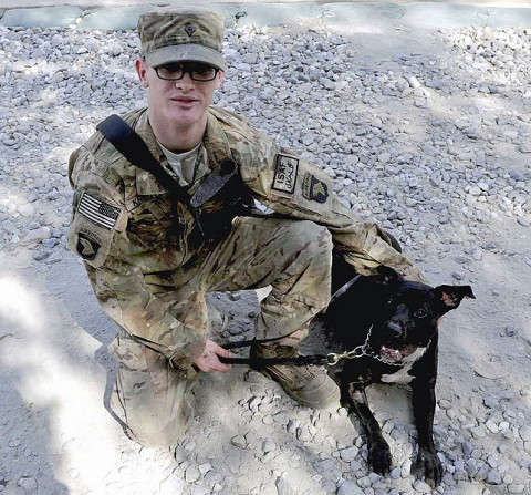 U.S. Army Spc. Matt Kreutzer, a military working dog handler with 1st Brigade Combat Team, 101st Airborne Division, and Sgt. Mimsy, a military working dog, stop for a photo during training at Forward Operating Base Wright, Kunar province, Afghanistan. Mimsy was recently released from quarantine after rescuing Kreutzer from a feral dog during a recent foot patrol. (U.S. Army Photo by Sgt. Shawn Vradenburg, Provincial Reconstruction Team Kunar)