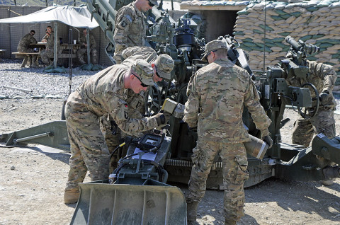 U.S. Army Soldiers with Battery A, 2nd Battalion, 320th Field Artillery, 1st Brigade Combat Team, 101st Airborne Division, practice using the Enhanced Portable Inductive Artillery Fuse Setter on a XM1156 Precision Guidance Kit Fuse and the M795 Rocket-Assisted Projectile April 28, 2013 at Forward Operating Base Joyce, Kunar Province, Afghanistan. (U.S. Army photo by Sgt. Jon Heinrich, CT 1-101 Public Affairs)