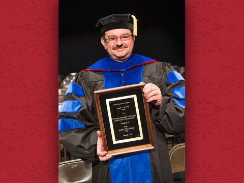 Dr. Andriy Kovalskyy, associate professor of physics, with his Hawkins Award. (Photo by Beth Liggett/APSU)