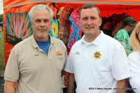 Hilltop Super Market manager Mike Jackson and Montgomery County Sheriff John Fuson