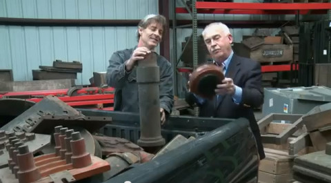 Sculptor Mike Andrews (left) and Clarksville Foundry President Charlie Foust sort through antique foundry pattern pieces for the ?New Old Stock? sculptures.