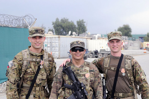 Three U.S. Army soldiers of 1st Brigade Combat Team, 101st Airborne Division, stand with their medals after completing a 25 kilometer Danish Contingent March, April 20th, 2013. (Photo by Sgt. Jon Heinrich)