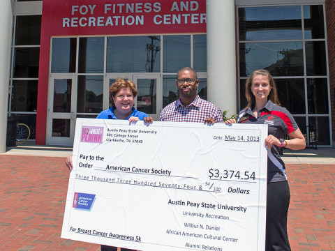 Henderson Hill III (center), director of the Wilbur N. Daniel African American Cultural Center at APSU, and Lauren Wilkinson (right), assistant director of the APSU University Recreation, present a check to Jerri Rule, community representative with the American Cancer Society. The proceeds are from the annual Breast Cancer Awareness 5K held April 13th on the main APSU campus. (Photo by Beth Liggett, APSU photographer)