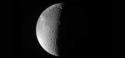 The Cassini spacecraft looks down, almost directly at the north pole of Dione. The feature just left of the terminator at bottom is Janiculum Dorsa, a long, roughly north-south trending ridge. (Image credit: NASA/JPL/Space Science Institute)