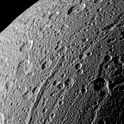The Cassini spacecraft swooped in for a close-up of the cratered, fractured surface of Saturn's moon Dione in this image taken during the spacecraft's Jan. 27, 2010, non-targeted flyby. (Image credit: NASA/JPL/Space Science Institute)