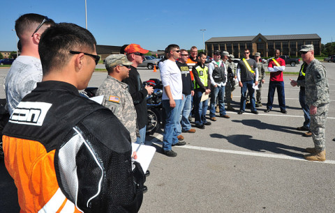 U.S. Army Lt. Col. Joel D. Hamby, the 4th Brigade Combat Team, 101st Airborne Division's rear-detachment commander, discusses the importance of motorcycle safety awareness with Currahee motorcycle owners representing all the battalions and various levels of rider experience within the brigade, May 15, 2013, as part of the brigade's observance of Motorcycle Safety Awareness Month at Fort Campbell, Ky. (U.S. Army photo by Sgt. Kimberly K. Menzies, 4th Brigade Combat Team Public Affairs)