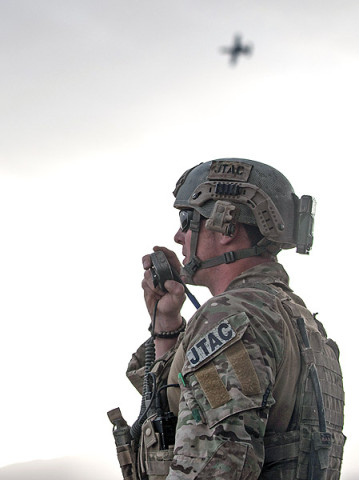 PAKTIA PROVINCE, Afghanistan - U.S. Air Force Staff Sgt. Justin Marsh, a joint tactical air controller, guides an A-10 Thunderbolt II onto an insurgent's position during Operation Sham Shir, April 24, 2013, Sahak, Afghanistan.  (U.S. Army National Guard Sgt. Joshua Edwards)