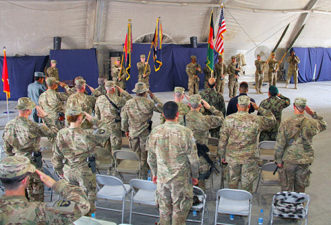 U.S. Army Soldiers and Afghan National Security Force members, attending the transfer of authority ceremony, salute the National flags of Afghanistan and the United States of America during the playing of each country's National Anthem at Forward Operating Base Salerno, on May 22, 2013. The transfer of authority ceremony signifies the beginning of the Currahee's mission as a partner with their Afghan National Security Force partners. (Photo by U.S. Army Sgt. Justin Moeller, 4th Brigade Combat Team, 101st Airborne Division)