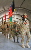 The colors of the 3rd and 4th Brigade Combat Team, 101st Airborne Division, preceded by the national flags of Afghanistan and the United States of America, are marched out at the closing of the transfer of authority ceremony at Forward Operating Base Salerno, on May 22nd, 2013.