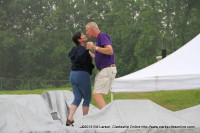 Mike Riley dances with his wife in the rain