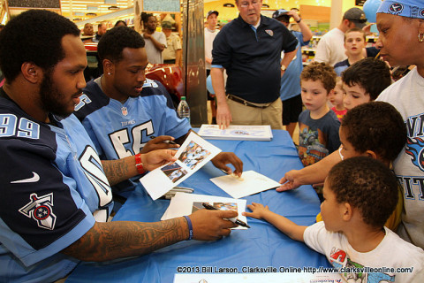 Akeem Ayers and Jurrell Casey visit with young fans at the Lowes Drive Kroger's in Clarksville, TN on Tuesday