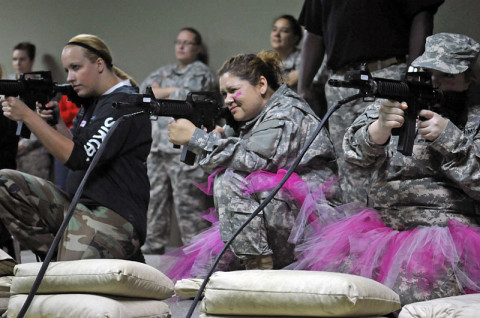 Lady Night Stalkers from 1st Battalion, 160th Special Operations Aviation Regiment (Airborne) conduct rifle training at the Engagement Skills Trainer during the Pink Platoon event May 2, 2013 at Fort Campbell, Ky.  (Photo by Staff Sgt. Rick Branch, 160th SOAR (A) Public Affairs)