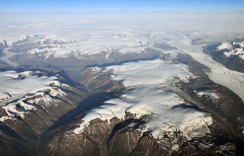 Peripheral glaciers and ice caps (isolated from the main ice sheet, which is seen in the upper right section of the image) in eastern Greenland. (Credit: Frank Paul, University of Zurich.)