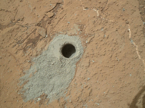 "NASA's Mars rover Curiosity drilled into this rock target, ""Cumberland,"" during the 279th Martian day, or sol, of the rover's work on Mars (May 19, 2013) and collected a powdered sample of material from the rock's interior. Analysis of the Cumberland sample using laboratory instruments inside Curiosity will check results from ""John Klein,"" the first rock on Mars from which a sample was ever collected and analyzed. (Image Credit: NASA/JPL-Caltech/MSSS)"