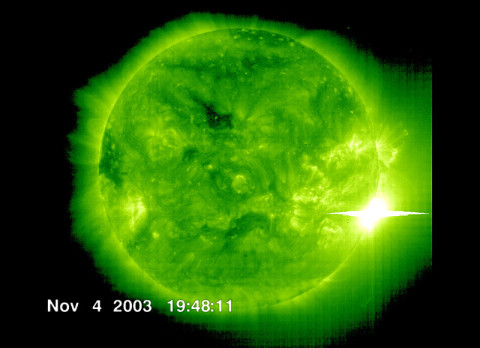 The Solar and Heliospheric Observatory spacecraft captured this image of a solar flare as it erupted from the sun early on Nov 4, 2003. This was the most powerful flare measured with modern methods, classified as an X28. (Credit: ESA and NASA/SOHO)