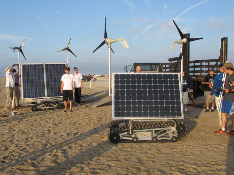 Students from a NASA Goddard summer engineering boot camp test two prototypes of GROVER at a beach in Asseteague Island, MD, in 2011. The prototype in front is similar to the one NASA will test in Greenland in May 2013. (Credit: NASA/Michael Comberiate)