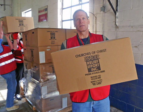 American Red Cross worker Bob Tyler loads food boxes to be distributed to residents of Stewart County, Tennessee, who were affected by flash floods. (Robert W. Wallace)