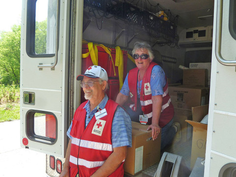 """Tom and Rene King, Red Cross volunteers from Nashville, Tennessee, take a break from distributing food and clean-up supplies to persons affected by flash flooding in north-central Tennessee. Tom and Rene are dedicated volunteers who recently responded to the recovery work after Superstorm Sandy. """"We signed up 30 years ago,"""" noted Tom, """"but it's only during the past two years or so that we've had the time to respond to the call for disaster relief."""" (Robert W. Wallace)"""