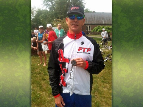 Russ Shemberger of RPM Massage in Clarksville displays the second-place medal he won at the annual Tri Ancilla sprint triathlon held Saturday, May 18th at Ancilla College in Donaldson, IN.