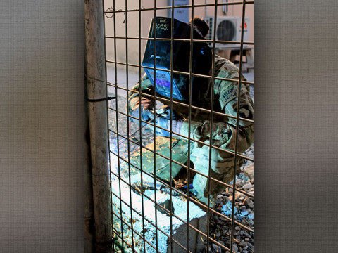 U.S. Army Spc. April Harvey, a metal worker with Company B, 426th Brigade Support Battalion, 1st Brigade Combat Team, 101st Airborne Division (Air Assault), increases security by welding heavy duty hinges onto a series of gates on Forward Operating Base Fenty, Nangarhar province, Afghanistan, Jan. 16, 2013. (U.S. Army Photo by Sgt. 1st Class John D. Brown, CT 1-101 Public Affairs)