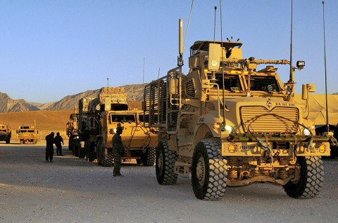 U.S. Soldiers assigned to the 3rd Platoon, 1245th Transportation Company, 1034th Combat Sustainment Support Battalion, escort military vehicles in preparation for a convoy escort team mission en route to two forward operating bases in the Regional Command North, at Mazar-e-Sharif, Balkh province, Afghanistan, June 18, 2013. (U.S. photo by Sgt. Sinthia Rosario/Released)