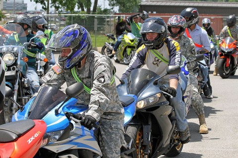 "Motorcycle riders within the 3rd Brigade Combat Team ""Rakkasans,"" 101st Airborne Division (Air Assault), prepare to ride their motorcycles to an obstacle course during a mentorship day for riders at Fort Campbell, Ky., June 12, 2013. The Rakkasans have been conducting motorcycle mentorship days for the past eight years, providing assistance and classes to riders within the brigade. (Photo by Army Spc. Brian Smith-Dutton 3/101 Public Affairs)"