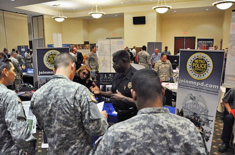 Metropolitan Police Officer Sgt. Connie Tripp talks with Soldiers at the June 26th job fair at Fort Campbell.  More than 30 employers took part in the CivilianJobs.com job fair sponsored by the Fort Campbell Army Career and Alumni Program office. (Photo by Nondice Thurman, Fort Campbell Public Affairs)