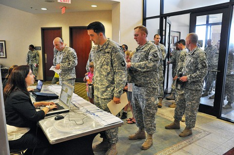 Soldiers line up to check in for the CivilianJobs.com job fair sponsored by the Fort Campbell Army Career and Alumni Program office. Hundreds of transitioning service members, veterans, and their family members took part in the event. (Photo by Nondice Thurman, Fort Campbell Public Affairs)