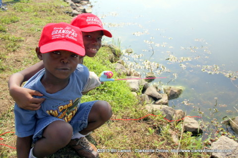 Two boys fishing at Liberty Park during last year's Free Fishing Day.