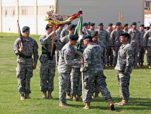 Lt. Col. David Diamond accepts the 1st Battalion, 5th Special Forces Group (Airborne) colors from Col. Scott Brower, commander of the 5th SFG (A), as he assumes command from Lt. Col. Andrew Hanson during a ceremony at Fort Campbell, KY, June 13th, 2013. (U.S. Army photo)