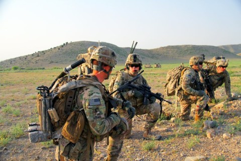 Soldiers with Easy Company, 2nd Battalion, 506th Infantry Regiment, 4th Brigade Combat Team, 101st Airborne Division, take a knee in anticipation of heading out on a mission in Khowst Province, Afghanistan, on June 2, 2013. (Photo by Sgt. Justin A. Moeller, 4th Brigade Combat Team Public Affairs)