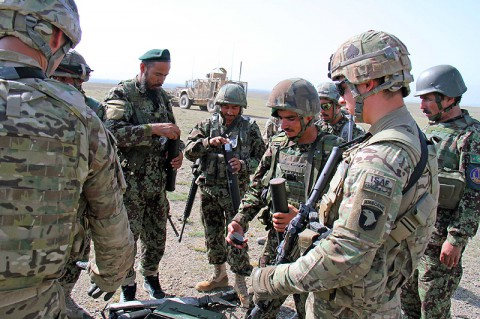 Soldiers with Easy Company, 2nd Battalion, 506th Infantry Regiment, 4th Brigade Combat Team, observe as the Afghan National Army's 2nd Khandak, 1st Brigade, 203rd Corps, prepare their 60mm mortar prior to a live fire exercise in Khowst Province, Afghanistan, June 22, 2013. (Photo by Sgt. Justin A. Moeller, 4th Brigade Combat Team Public Affairs)