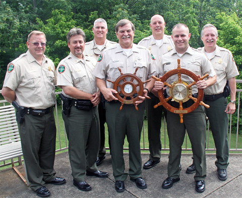 Tommy Stockling (left) and Nick Luper are with their respective awards after being introduced as the Tennessee Wildlife Resources Agency part-time Boating Officer and Boating Officer of the Year for 2012.  Also pictured are (from left) District 31 Lt. Tim Singleton, District 31 Cpt. Roy Cannon, Region III Maj. CJ Jaynes, Boating and Law Enforcement Division Chief Darren Rider, and Asst. Boating and Law Enforcement Chief Glenn Moates.