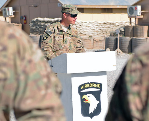 """U.S. Army Sgt. 1st Class Gregory Funk, noncomissioned officer in charge, Forward Operating Base Lightning Base Defense Operations Center, 4th Battalion, 320th Field Artillery Regiment, 4th Brigade Combat Team """"Currahee"""", 101st Airborne Division (Air Assault), conducted a combat patching ceremony for the Currahee Soldiers at Forward Operating Base Lightning June 6th, 2013. (U.S. Army National Guard photo by Spc. Ryan Scott, 129th Mobile Public Affairs Detachment)"""