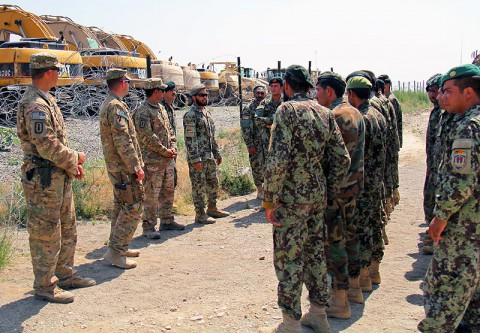Soldier with the 4th Khandak, 1st Brigade, 203 Corps, receive a breifing from Sgt. 1st Class Sayed Anwar Shah Sadad, an Explosive Ordnance Disposal Technician with the 4th Khandak, 1st Bde., 203rd Corps, prior to doing a counter improvised explosive device lane, June 20, 2013 at Camp Parsa, Afghanistan. (Photo by U.S. Army Sgt. Justin A. Moeller, 4th Brigade Combat Team Public Affairs)