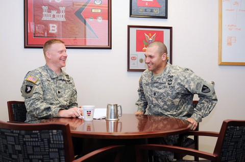 Lt. Col. Phillip J. Borders, the commander of the 326th Engineer Battalion, 101st Sustainment Brigade, 101st Airborne Division (Air Assault), and his senior enlisted adviser, Command Sgt. Maj. Ramon M. Fisher, share a laugh during a conversation about the battalion March 14, at Fort Campbell. They attribute their similar approach to the military to the fact they both spent time in the 326th as younger Soldiers. (U.S. Army photo by Sgt. Leejay Lockhart, 101st Sustainment Brigade Public Affairs)