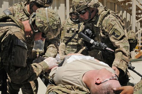 Soldiers with Task Force Lifeliner treat a mock-injured soldier during their training exercise June 7, 2013, at Bagram Air Field in Afghanistan. The training known as MASCAL (mass-casualty) prepares the medics and soldiers with combat lifesaver qualifications for situations in which the number of casualties exceeds the aid station capabilities to provide medical care. (U.S. Army photo by Sgt. Sinthia Rosario, Task Force Lifeliner Public Affairs)