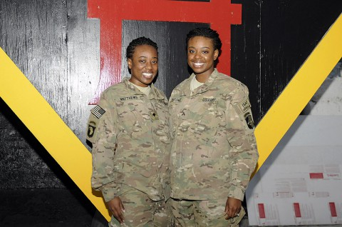 U.S. Army Cpl. Victoria P. Stokes a human resource specialist with Task Force Lifeliner and her sister Spc. Alisa M. Matthews a geospatial engineer with Combined Joint Intelligence, pose for a photo during their deployment to Bagram Air Field in Parwan province, Afghanistan June 12th, 2013. (U.S. Army photo by Sgt. Sinthia Rosario/Released)