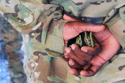 "Waiting in the hands of Command Sgt. Maj. Lamont Christian, command sergeant major of 2nd Battalion, 506th Infantry Regiment, 4th Brigade Combat team ""Currahee"", 101st Airborne Division (Air Assault), is the combat patch for the 101st Airborne Division known as the ""Screaming Eagle"", that the Currahees donned during a patch ceremony at Forward Operating Base Salerno, Afghanistan, on June 6, 2013 (U.S. Army photo by Sgt. Justin A. Moeller, 4th Brigade Combat Team Publuc Affairs)"