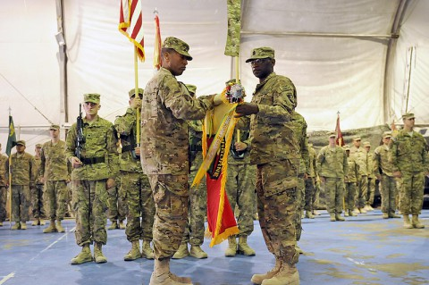 U.S. Army Col. Charles R. Hamilton, commander of the 101st Sustainment Brigade and Task Force Lifeliner and Command Sgt. Maj. Eugene J. Thomas Jr., unfurled the unit's colors during the transfer of authority ceremony June 8, 2013, at Bagram Airfield in Parwan province, Afghanistan. (U.S. Army photo by Sgt. Sinthia Rosario/Released)