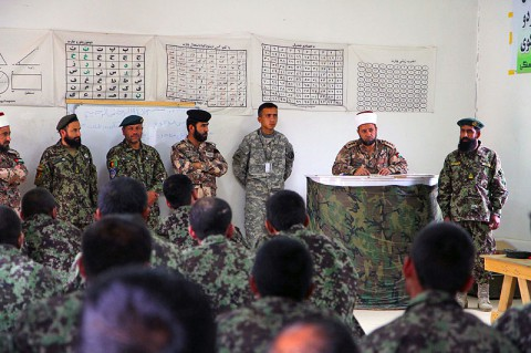 Capt. Imam Sabri Al Qudah with the Jordanian Engagement Team, based out of Bagram Air Field, Afghanistan, talks to soldiers of the Afghan National Army's 5th Kandak during a meeting June 11, 2013, in Khowst province, Afghanistan. (U.S. Army photo Sgt. Justin Moeller, 4th Brigade Combat Team Public Affairs)