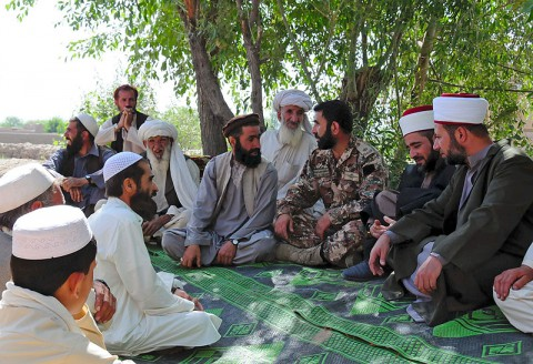 Maj. Abdel Latif, along side Imams Capt. Imam Sabri Al Qudah and Lt. Imam Ahmad Shemayli, with the Jordanian Engagement Team, based out of Bagram Air Field, Afghanistan, talk with village elders and mullahs about the Amman message during a meeting June 11, 2013, in Khowst province, Afghanistan. (U.S. Army photo Sgt. Justin Moeller, 4th Brigade Combat Team Public Affairs)
